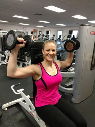 lifting-dumbells in pink tanktop