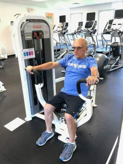 older man rowing machine